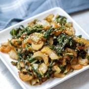 Bok Choy on white plate with soy garlic glaze