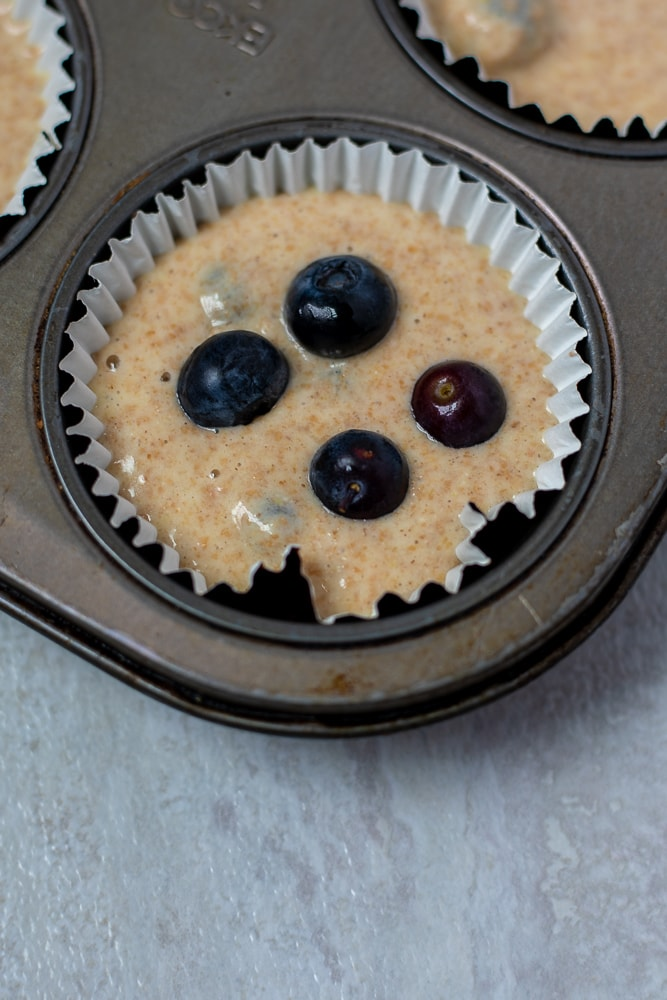 Blueberries on top of Blueberry Muffin Batter