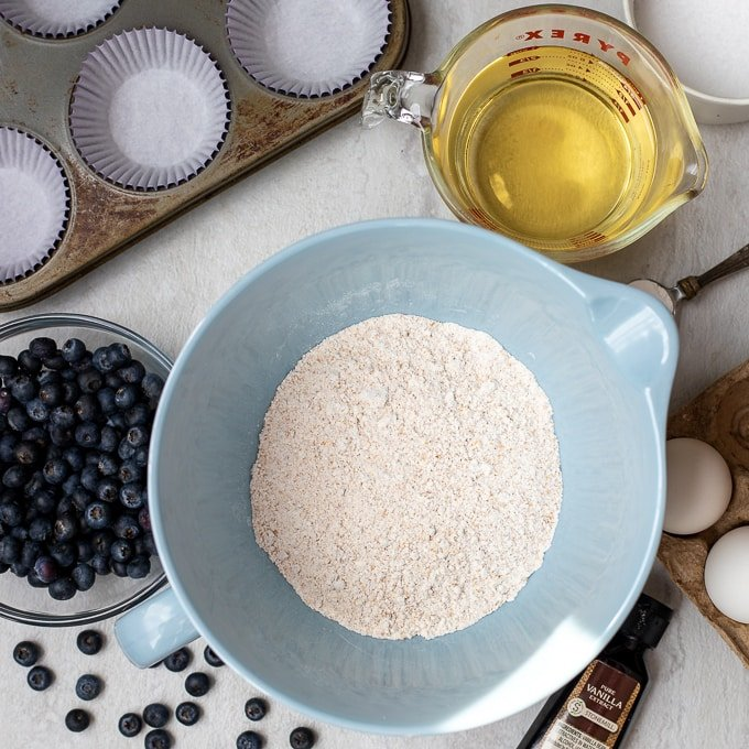 Dry ingredients for Blueberry Muffins in blue mixing bowl