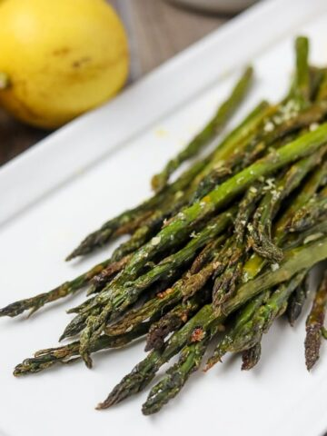 Asparagus on White Platter with parmesan