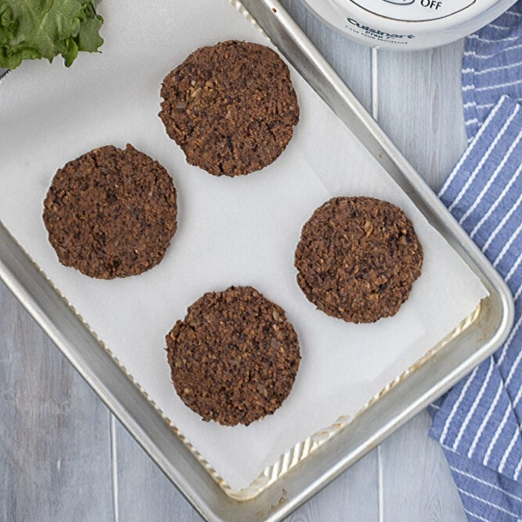 4 Black Bean Burgers on parchment lined baking sheet