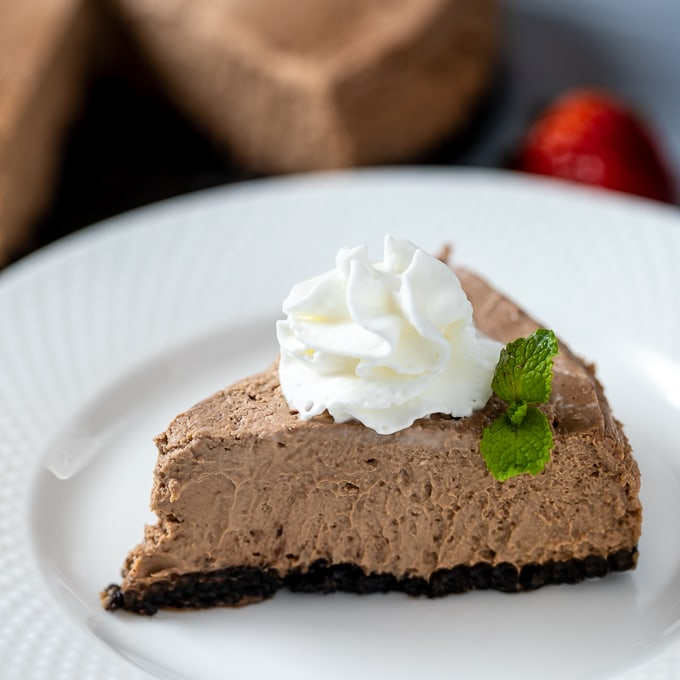 Slice of Instant Pot Chocolate Cheesecake on white plate