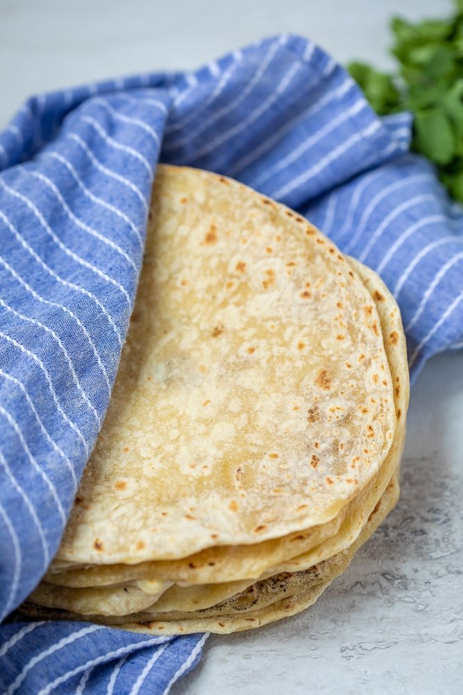 Homemade Flour Tortillas in blue cloth