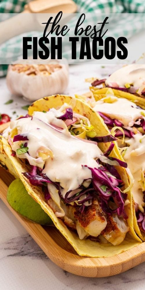 This is the easiest, most flavorful recipe for fish tacos! Tender white fish is baked to flaky perfection after being rubbed with a bright, spicy seasoning rub. The tacos are assembled with a fresh cabbage slaw and a creamy chipotle sauce for the perfect balance in flavors and textures. These fish tacos are must make, healthy family meal!