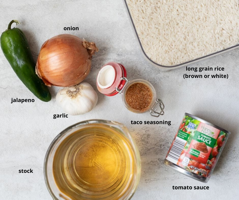Ingredients for Mexican Rice on white counter with text overlay
