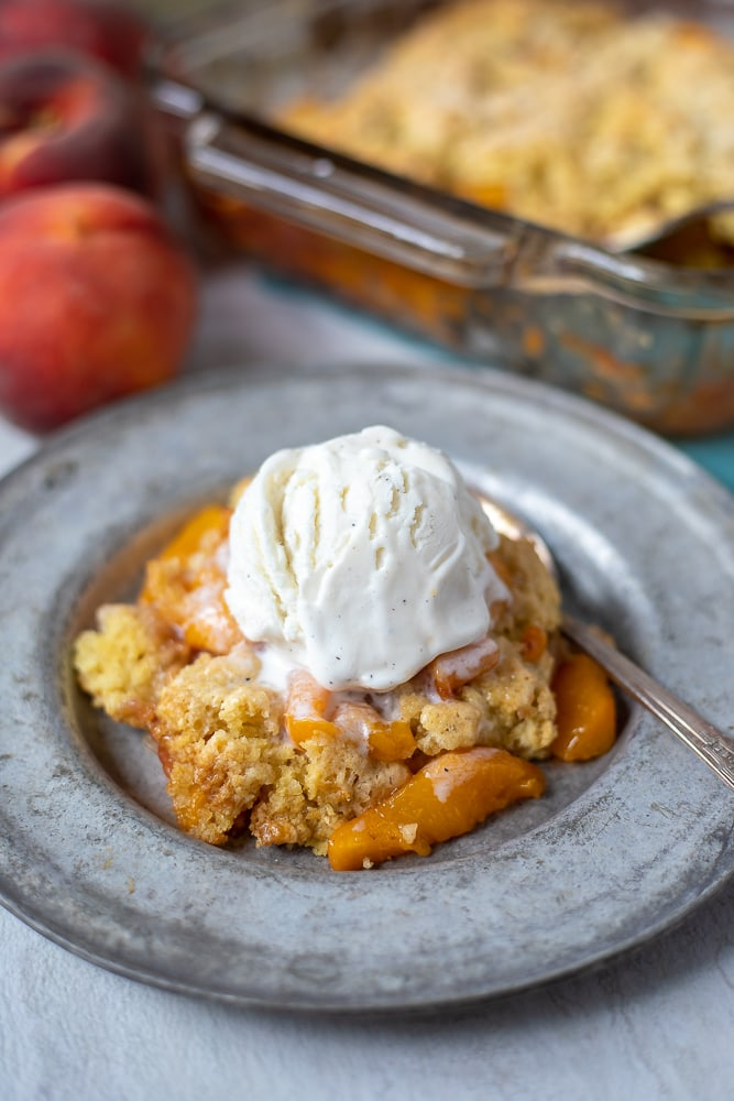 Peach Cobbler served with scoop of ice cream