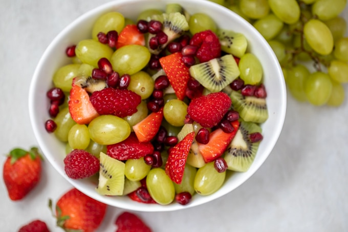 Red and Green Fruit Salad in White Bowl
