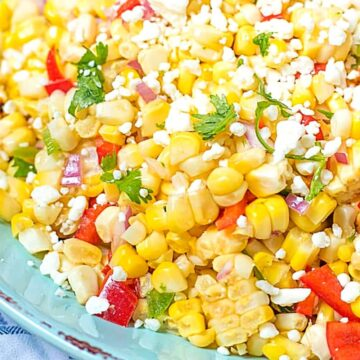 Close up of corn salsa topped with feta and cilatnro
