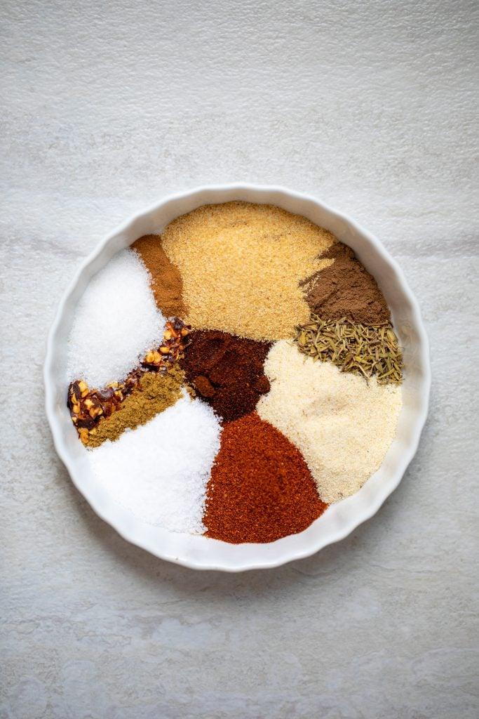 Spices for jerk seasoning on white platter