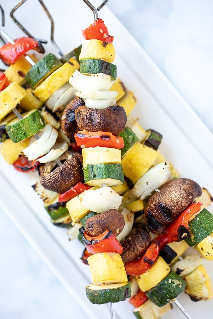 Grilled Vegetable Kabobs on white platter