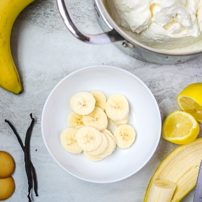Bananas in white bowl with lemon extract