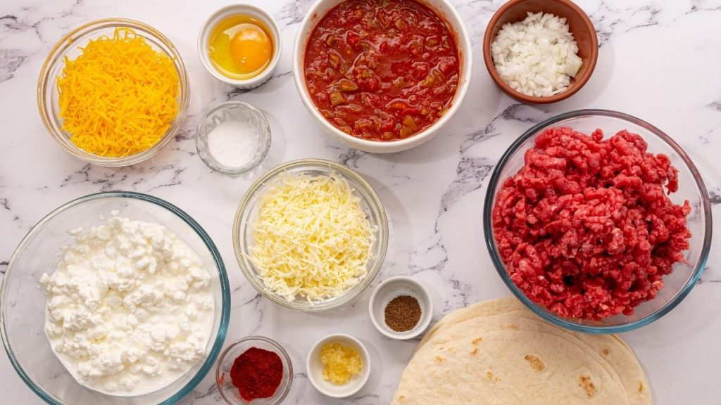 Ingredients for mexican lasagna on white counter
