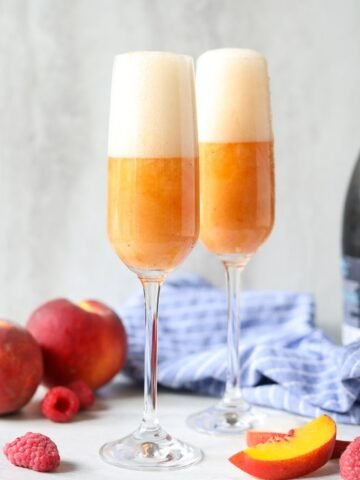 2 bellinis in champagne glasses