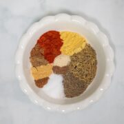 White dish with seasoning blend for Old Bay