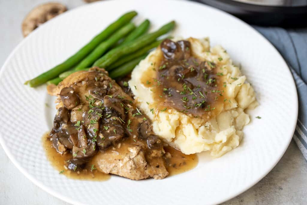 Plated Instant Pot Chicken Marsala served with potatoes and green beans
