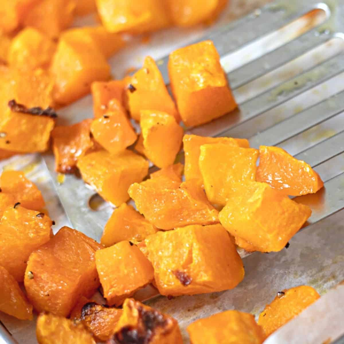 Spatula scooping up roasted squash.