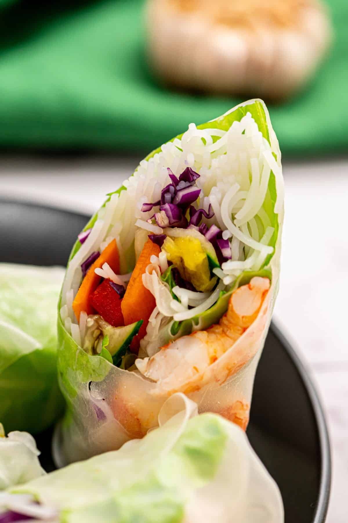 Spring Roll Cut Open showing fresh ingredients.