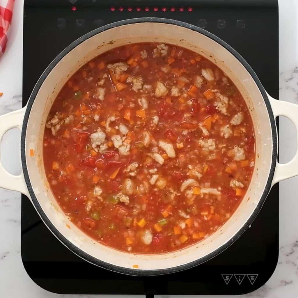 Ingredients for lasagan Soup in dutch oven pan.