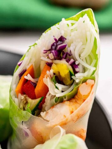 Fresh Spring Roll Cut Open showing fresh ingredients.