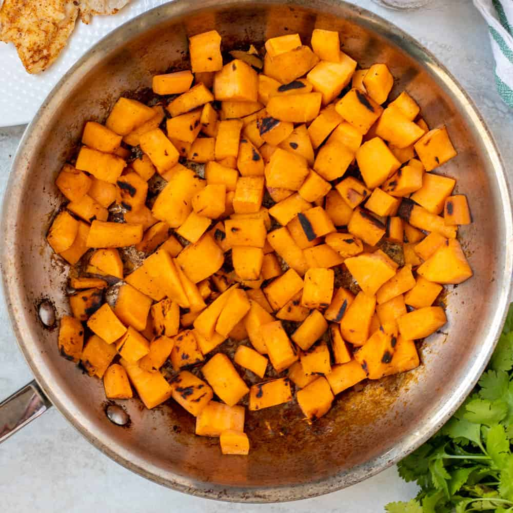 Sauteed Sweet potatoes in skillet.