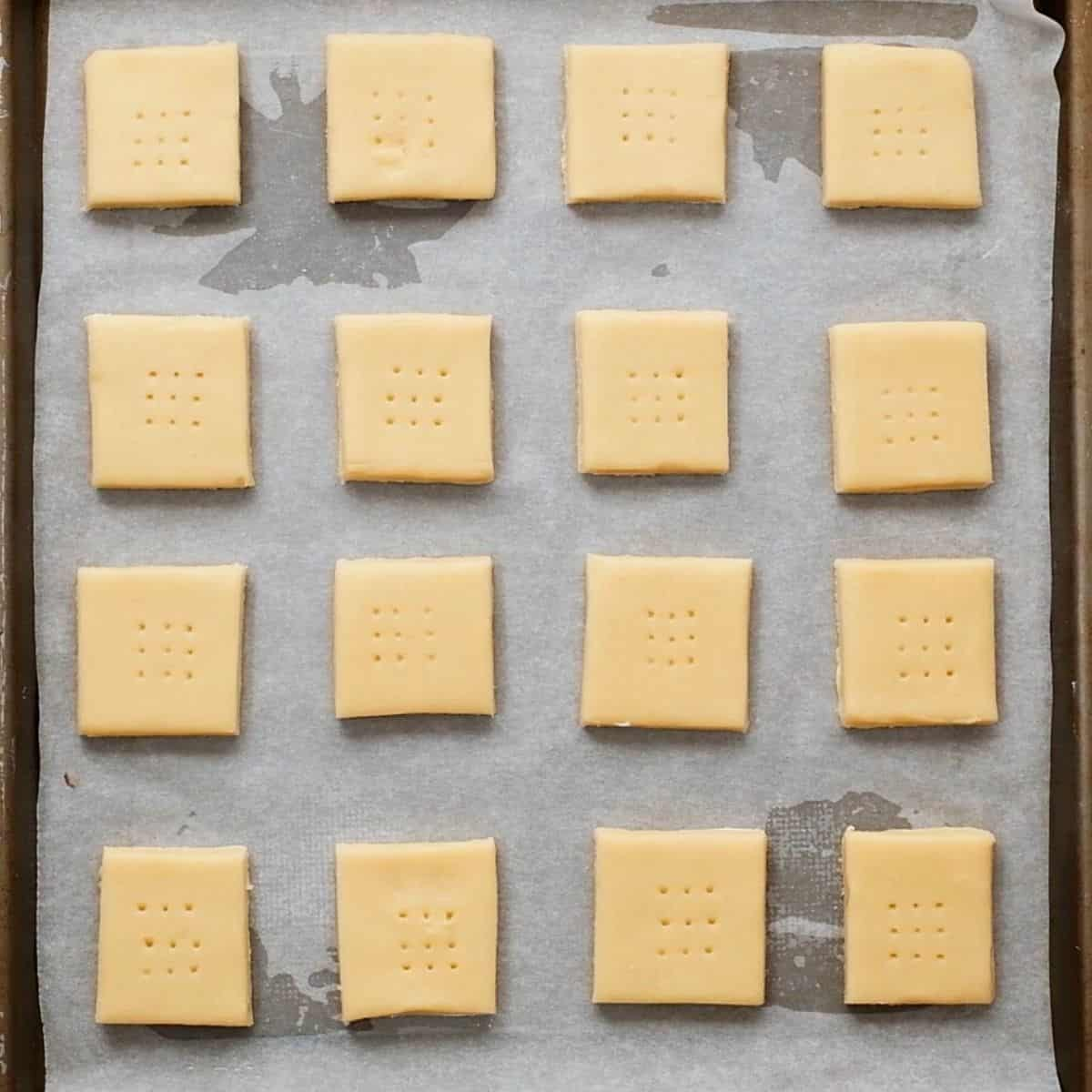 Shortbread cookies spaced out baking sheet.