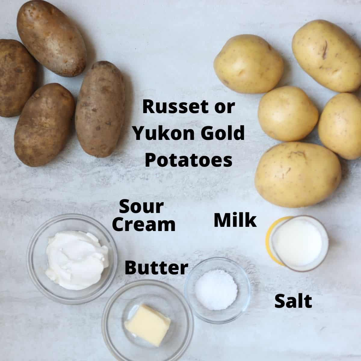 Ingredients for instant pot mashed potatoes labeled on white counter.