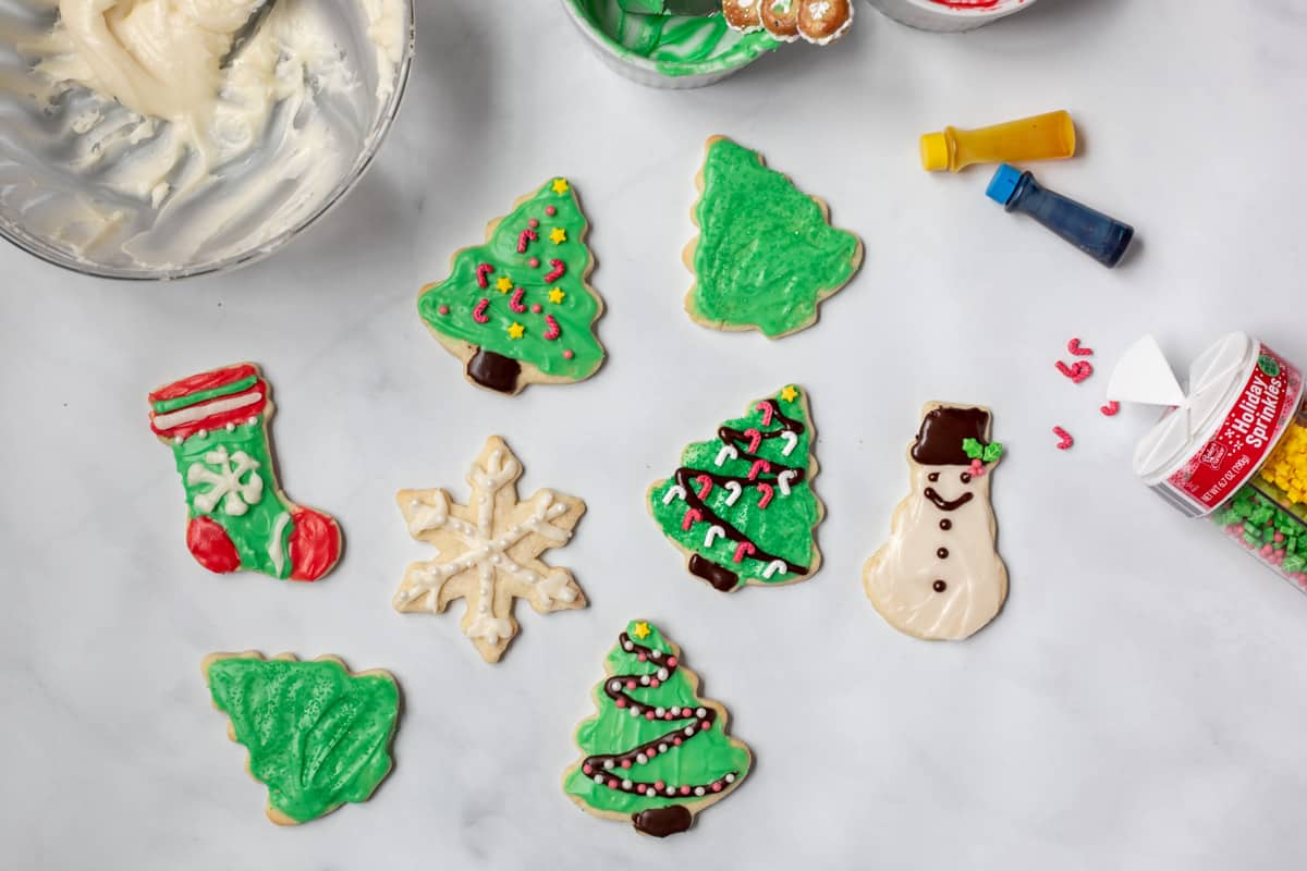 Iced Sugar Cookies decorated with sprinkles and piping.