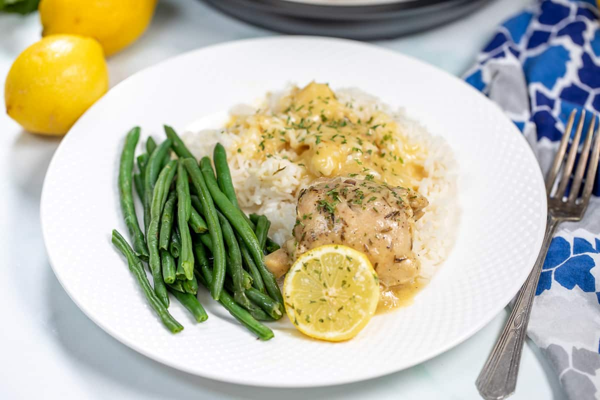 Lemon Garlic Chicken plated on white plate with green beans.
