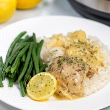Lemon Chicken on plate with white rice and green beans.