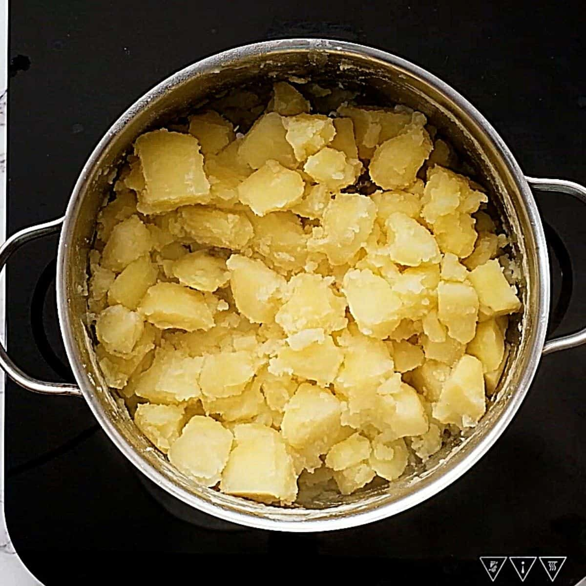 Cooked potatoes in pan.