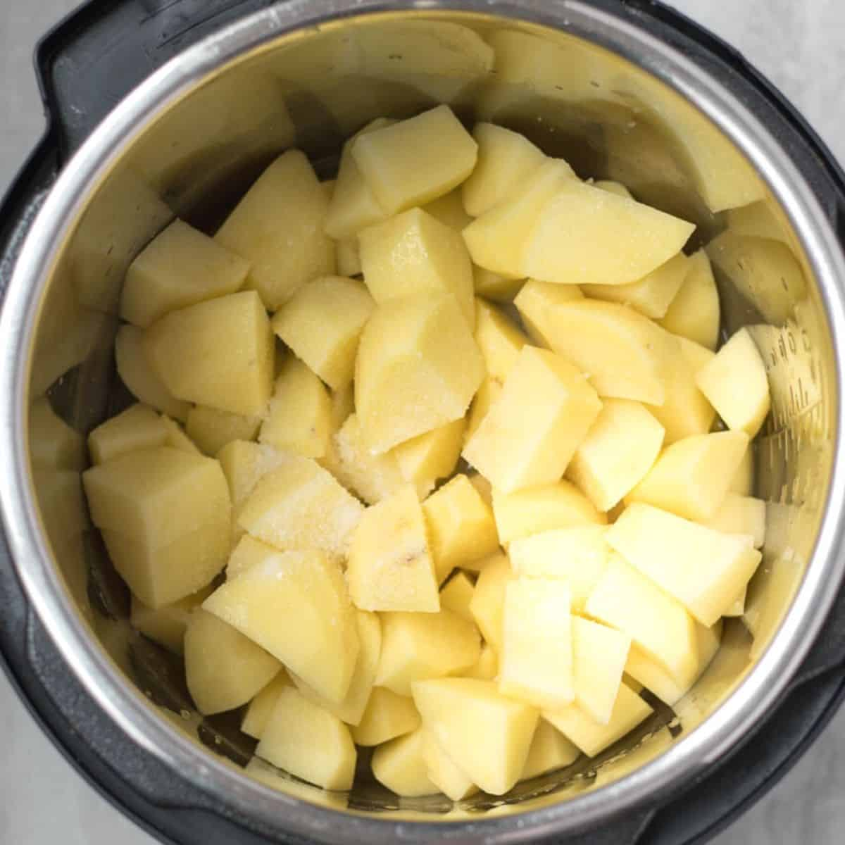 Raw Potatoes in the inner pot with salt and water.