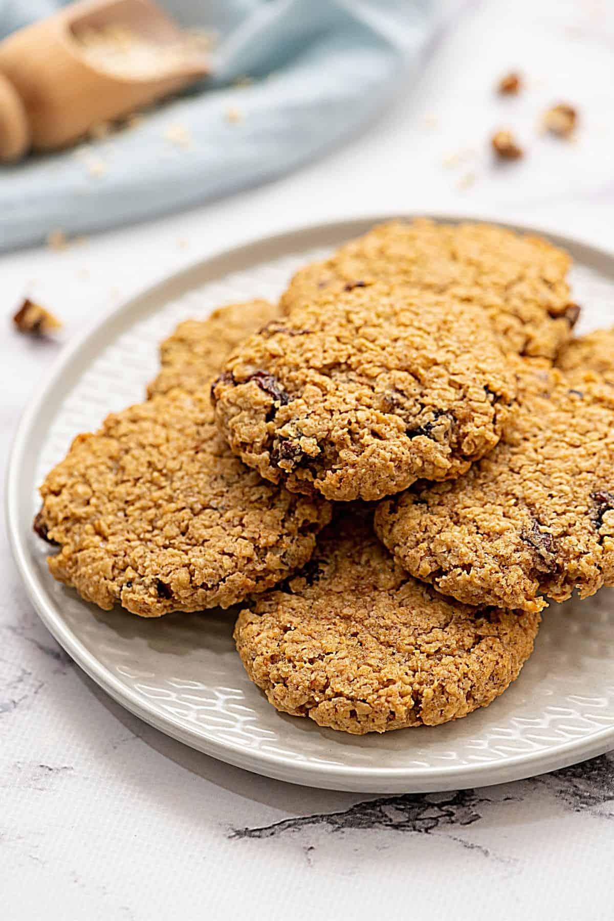 Plate of baked oatmeal raisin cookies.