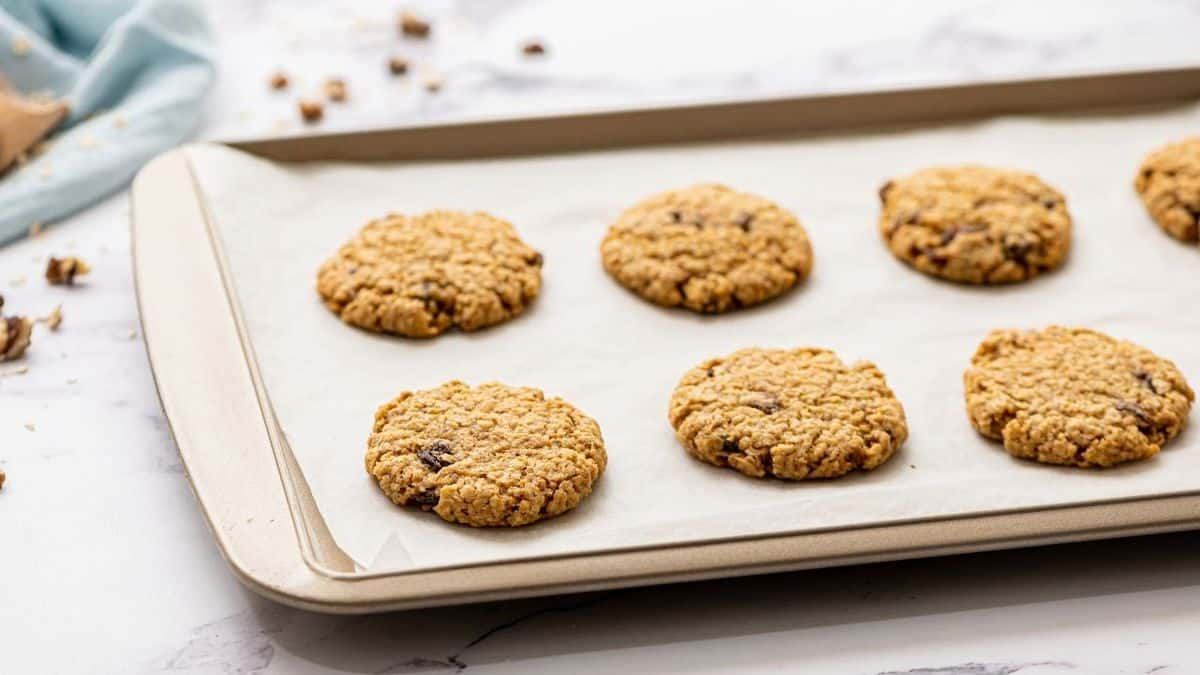 Baked Oatmeal Raisin Cookies on a sheet pan.