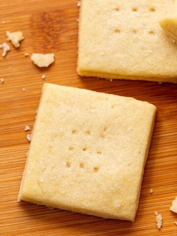 Baked Shortbread Cookies on wooden Cutting board.