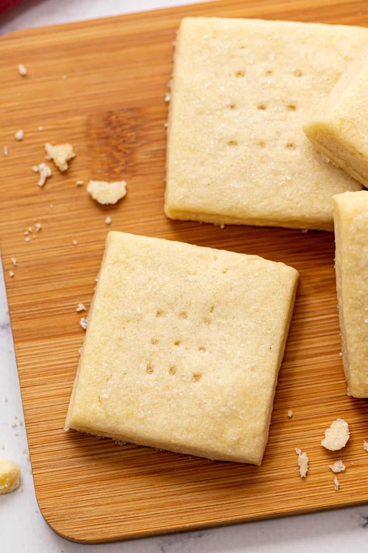 Baked shortbread cookies on cutting board.
