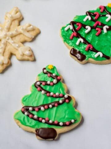Iced Sugar Cookies with green and white icing and sprinkles.