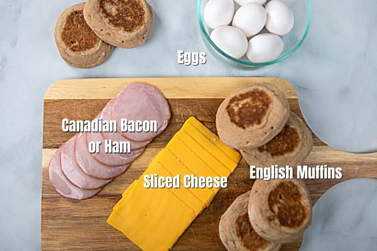 Ingredients for egg mcmuffins labeled on counter.