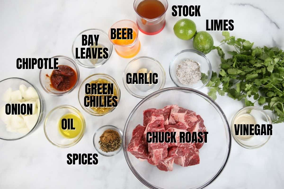 Ingredients for beef barbabcoa labeled on white counter.