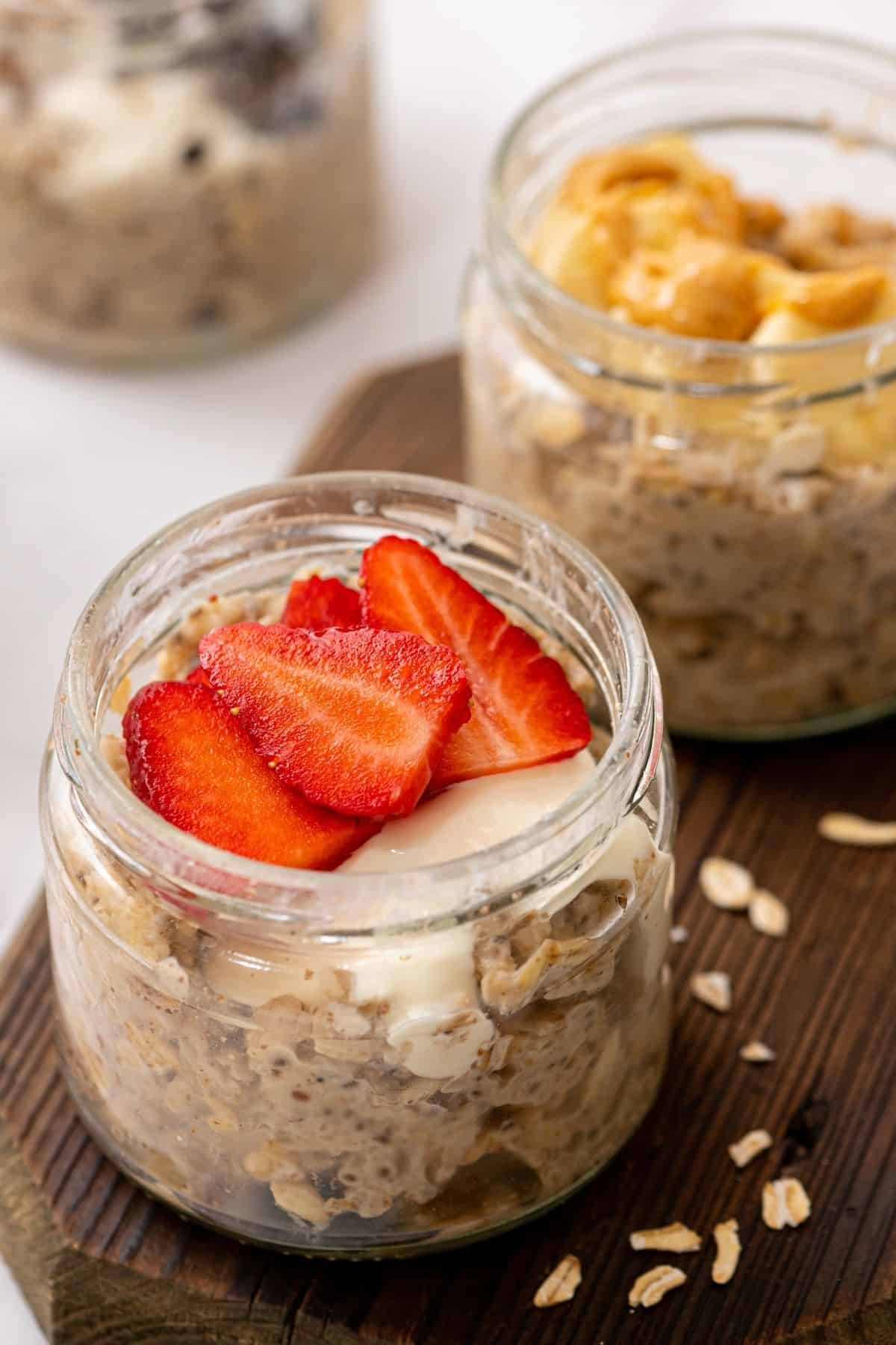 2 jars of overnight oatmeal topped with fresh fruit.
