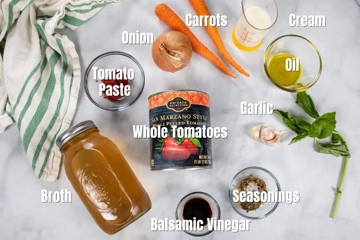 Ingredients for tomato soup labeled on counter.