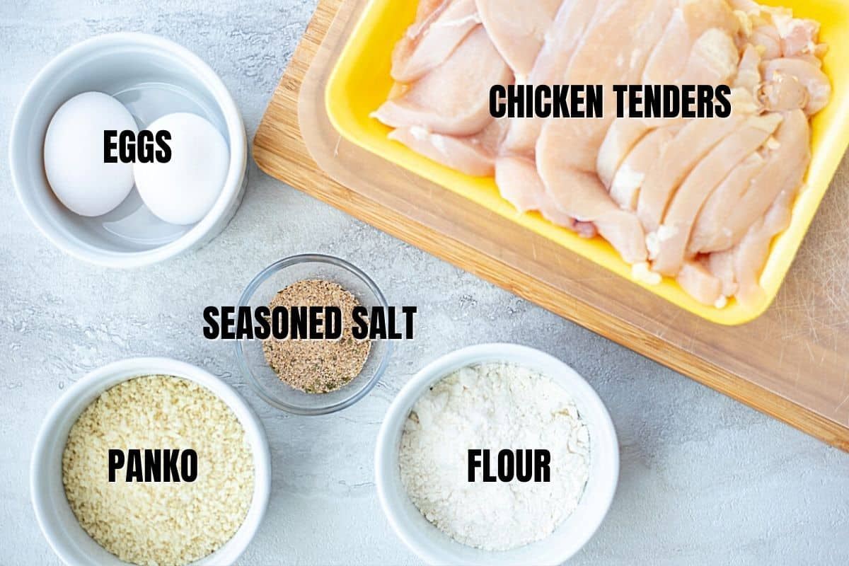 Ingredients for chicken tenders labeled on white counter.