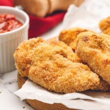 Homemade Chicken Tenders on platter.