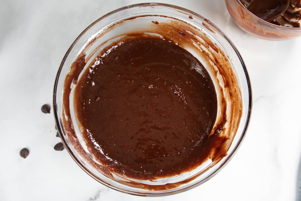 Molten lava cake batter in clear mixing bowl.