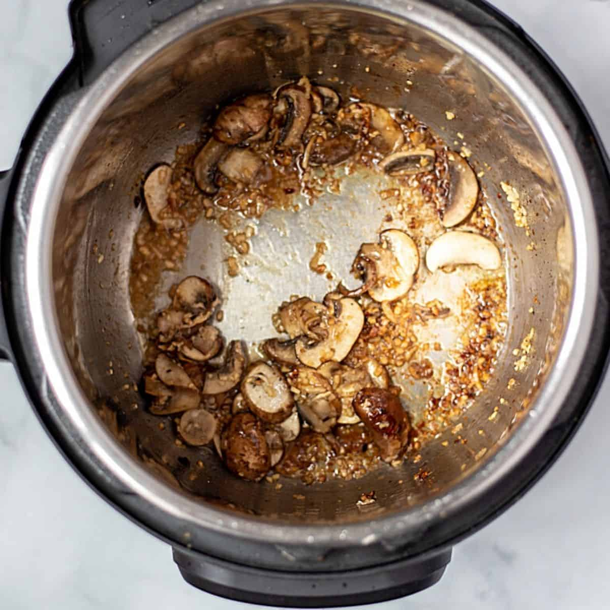 Sauted mushrooms and onions in inner pot.