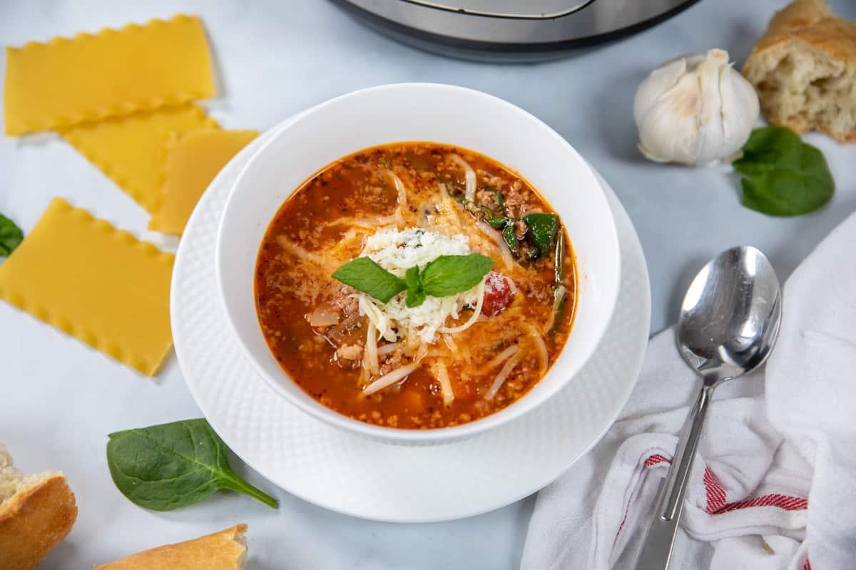 Bowl of Lasagna Soup next to instant pot.