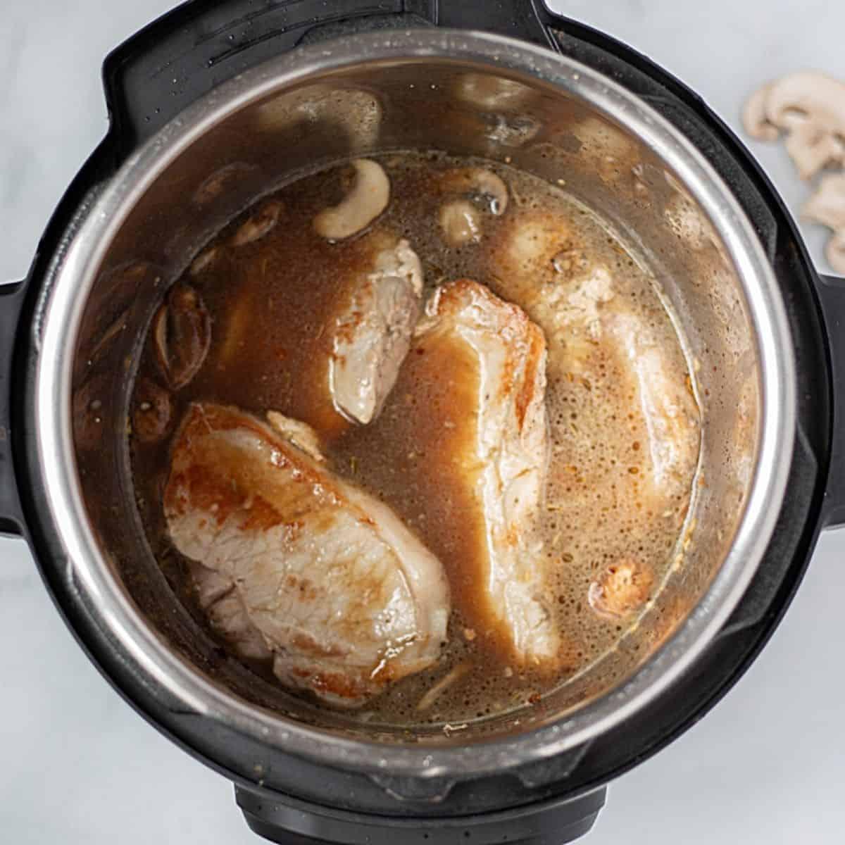 Pork chops and mushroom gravy in instant pot.