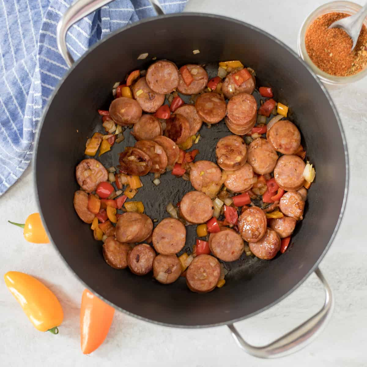 Sausage, peppers, and onions sauteed in large stock pan.