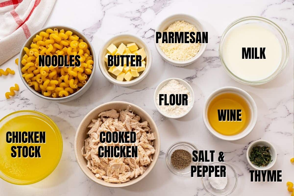 Ingredients for Creamy Chicken Casserole labeled on white counter.