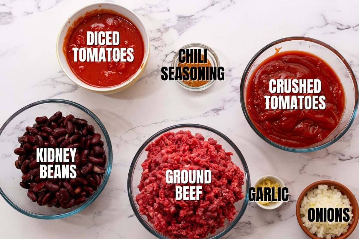 Ingredients for chili labeled on white counter.