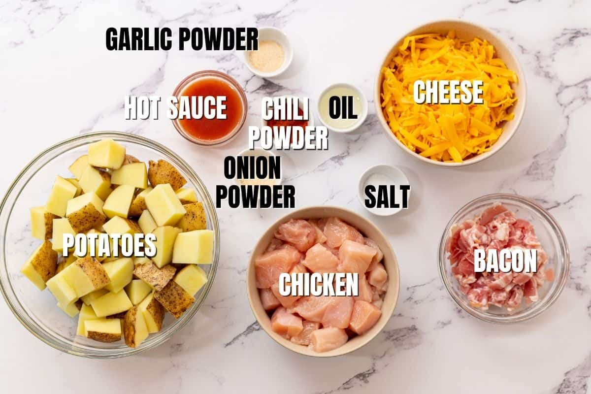 Ingredients for buffalo chicken bake labeled on counter.